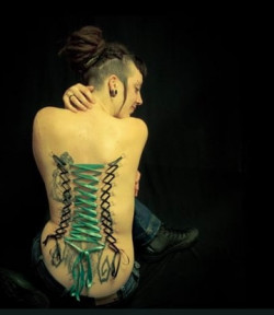 nude-woman-with-corset-piercings